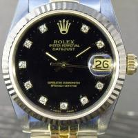 68273 Rolex Oyster Perpetual Datejust, Steel and Gold 31mm case with black diamond set dial, 18ct gold fluted bezel on a steel and gold jubilee bracelet. Box and papers dated 1991.