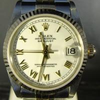 68273 Rolex Oyster Perpetual Datejust, Steel and Gold 31mm case with white dial and gold Roman numerals, 18ct yellow gold fluted bezel on a steel and gold jubilee bracelet. Box and papers dated 1993.