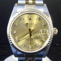 Rolex oyster perpetual date just midsize in steel and gold 31mm case diameter, champagne diamond set dial, 18ct fluted bezel. Steel and gold jubilee bracelet. Box and papers dated 1992.