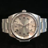 2010 114210 Rolex oyster perpetual Air king stainless steel 34mm case diameter grey Roman numeral dial.